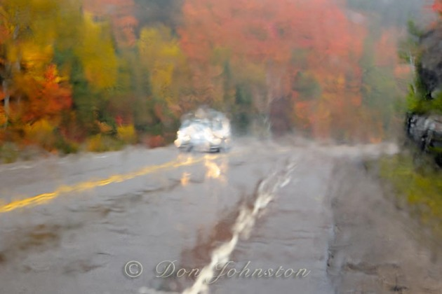 Algonquin's highway 60 seen through a rain-soaked window. 1/15 s @ f11 ISO 800