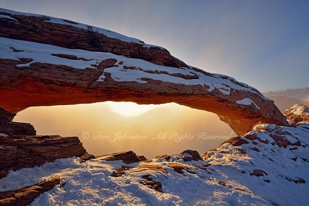 Mesa Arch in winter, with morning fog, Canyonlands National Park, Utah, USA