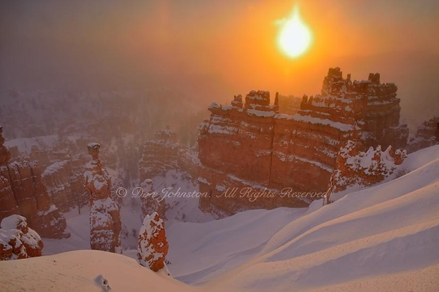 Hoodoos with winter snow and ice fog at dawn, from Sunset Point, Bryce Canyon National Park, Utah, USA