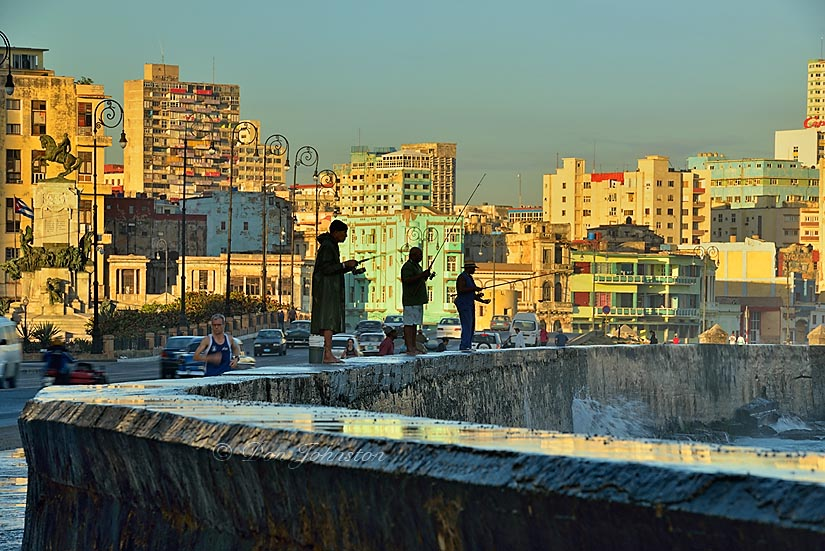 Malecón (officially Avenida de Maceo) Seawall with fishermen silhouetted against the Vedado neighbourhood. 1/15@f20