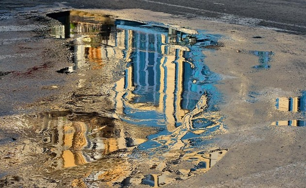 Street photogrphy in Old Havana- reflections in a water puddle