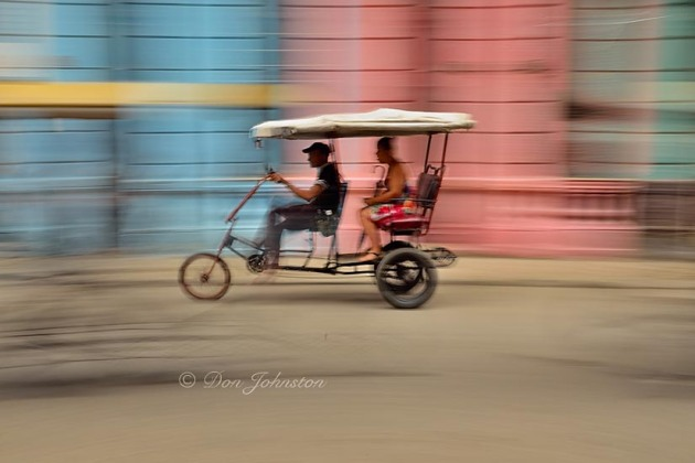 Bicycle taxi and colourful building, panning with camera. ½ s@f16 ISO 100